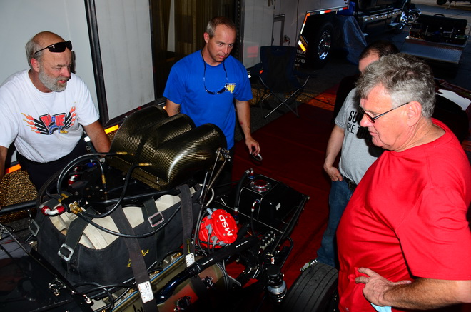 "Bubba Stanton (blue shirt) and car owner Roger Henson (in red) look over ""Spanky,"" the screw-blown Hemi that propelled Stanton to victory in Pro extreme at the first two PDRA events this season. In testing today (May 22) for the series' third race, Stanton was quickest overall with a 3.589 pass at 215.20 mph."