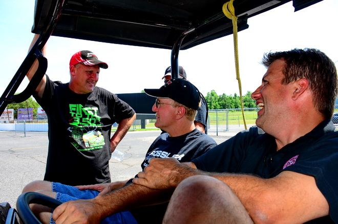 TRIO OF TEXANS -- Pro Boost driver Todd Moyer is flanked by fellow Texans and Pro Extreme pilots Frankie Taylor (left) and Don Wooton as they share a laugh in the staging lanes at Memphis International Raceway.