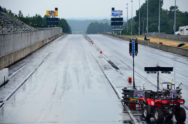It's Sunday, race day for PDRA Dragstock at Rockingham Dragway, and there should be race cars going down this track. However, a brief rain shower at 12:25, just minutes after round two of eliminations began, has put a hold on things. Track drying was already underway by 12:40, so hopefully we'll be underway again soon.