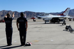 Thunderbirds maintenance professionals marshal in Maj. Michael Fisher, Thunderbird 8, and Lucas after a successful media flight. Lucas experienced the ride of his life aboard a U.S. Air Force F-16 Fighting Falcon. (U.S. Air Force photo/Tech. Sgt. Manuel J. Martinez)