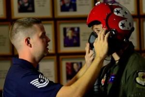 Tech. Sgt. Hall ensures Lucas has a proper seal on his oxygen mask. (U.S. Air Force photo/Tech. Sgt. Manuel J. Martinez)