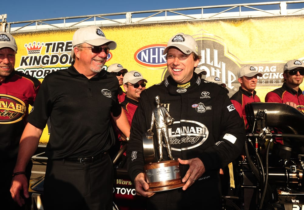 Mar. 13, 2011; Gainesville, FL, USA; NHRA top fuel dragster driver Del Worsham (right) and team owner Allan Johnson celebrate after winning the Gatornationals at Gainesville Raceway. Mandatory Credit: Mark J. Rebilas-